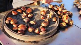 Turkish Vendor is Roasting Chestnut Closeup stock video