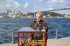 Turkish vendor sells bagels, Istanbul on the Bosphorus. Stock Photos