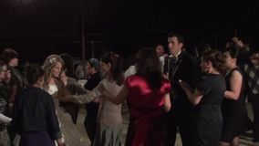 Turkish wedding dancing. People are dancing at the turkish wedding party, zoom out stock video