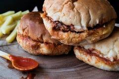 Turkish Wet Burger with sauce and potatoes. / islak hamburger Royalty Free Stock Image