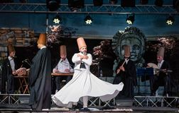 The Turkish whirling dancers or Sufi whirling dancers at Spirito. The Turkish whirling dancers or Sufi whirling dancers performing of the Mevlevi whirling Royalty Free Stock Photo