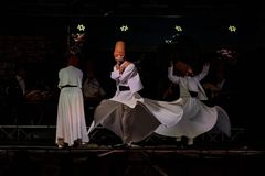 The Turkish whirling dancers or Sufi whirling dancers at Spirito. The Turkish whirling dancers or Sufi whirling dancers performing of the Mevlevi whirling Stock Photos