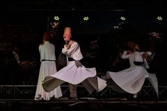 The Turkish whirling dancers or Sufi whirling dancers at Spirito. The Turkish whirling dancers or Sufi whirling dancers performing of the Mevlevi whirling Royalty Free Stock Images