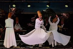 The Turkish whirling dancers or Sufi whirling dancers at Spirito. The Turkish whirling dancers or Sufi whirling dancers performing of the Mevlevi whirling Royalty Free Stock Image