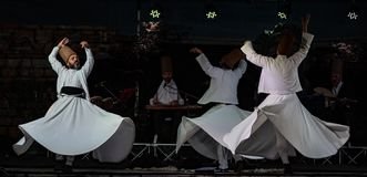 The Turkish whirling dancers or Sufi whirling dancers at Spirito. The Turkish whirling dancers or Sufi whirling dancers performing of the Mevlevi whirling Stock Image