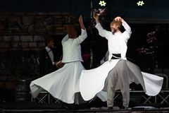 The Turkish whirling dancers or Sufi whirling dancers at Spirito. The Turkish whirling dancers or Sufi whirling dancers performing of the Mevlevi whirling Stock Photography