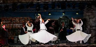 The Turkish whirling dancers or Sufi whirling dancers at Spirito. The Turkish whirling dancers or Sufi whirling dancers performing of the Mevlevi whirling Stock Images