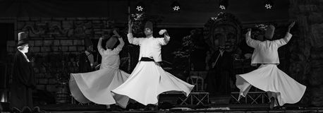 The Turkish whirling dancers or Sufi whirling dancers at Spirito. The Turkish whirling dancers or Sufi whirling dancers performing of the Mevlevi whirling Royalty Free Stock Photos