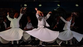 The Turkish whirling dancers or Sufi whirling dancers at Spirito. The Turkish whirling dancers or Sufi whirling dancers performing of the Mevlevi whirling Stock Photo