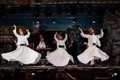 The Turkish whirling dancers or Sufi whirling dancers at Spirito royalty free stock photography