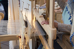 Turkish woman hands weaving traditional carpet closeup Stock Photography