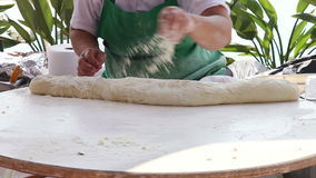 Turkish Woman Kneading Dough. For preparing traditional pancakes gozleme stock video footage