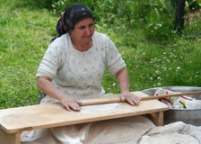 Turkish Woman making traditional Turkish bread Yufka Royalty Free Stock Photography
