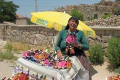 Turkish woman selling souvenir Royalty Free Stock Photo