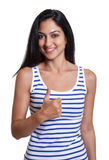 Turkish woman in a striped shirt showing thumb up Royalty Free Stock Photos