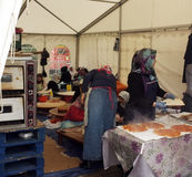 Turkish women cook in a tent Stock Photography