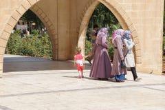 Turkish women in scarves with their children Stock Photo