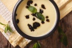 Turkish Yayla soup with rice, mint and yoghurt close-up. horizon Stock Image