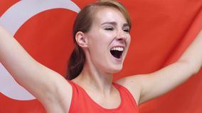 Turkish Young Woman celebrates holding the flag of Turkey in Slow Motion. High quality stock photos
