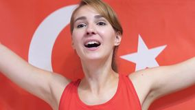 Turkish Young Woman celebrating while holding the flag of Turkey in Slow Motion. High quality stock image