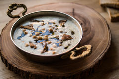 Turkish Yuvalama Soup. Turkish Yuvalama Soup in a Copper Bowl on a Wooden Surface Royalty Free Stock Photography