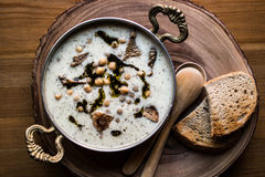 Turkish Yuvalama Soup. Turkish Yuvalama Soup in a Copper Bowl on a Wooden Surface Royalty Free Stock Photos