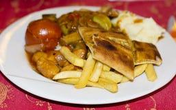 Turkisk matställe i en vit platta Arkivfoto
