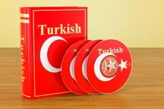 Turkisk språklärobok med flaggan av Turkiet och CD disketter på th stock illustrationer