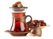 Turkiskt te i ett exponeringsglas Arkivbilder