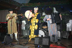 Turkmen folk music group Turkmenistan national Oriental mens costumes playing folk music on folk instruments. Royalty Free Stock Photography
