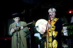 Turkmen folk music group Turkmenistan national Oriental mens costumes playing folk music on folk instruments. Stock Images