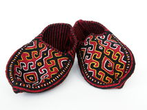 Turkmen traditional slippers. Turkmen traditional colorful hand-knitted slippers (or short socks) with geometrical pattern in dark red, black, yellow and white Royalty Free Stock Photos