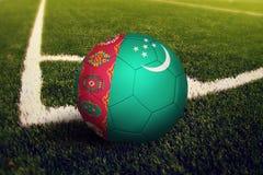 Turkmenistan ball on corner kick position, soccer field background. National football theme on green grass stock illustration