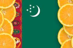 Turkmenistan flag in citrus fruit slices vertical frame royalty free stock photography