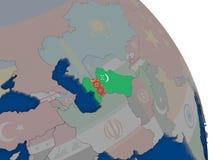 Turkmenistan with flag on globe Stock Photo