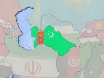 Turkmenistan with flag on globe Stock Image