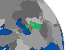 Turkmenistan and its flag on globe Stock Photo