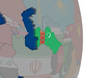 Turkmenistan with its flag Royalty Free Stock Photo