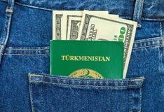 Turkmenistan passport and dollar bills Royalty Free Stock Photos