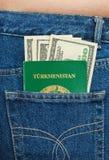 Turkmenistan passport and dollar bills Royalty Free Stock Image