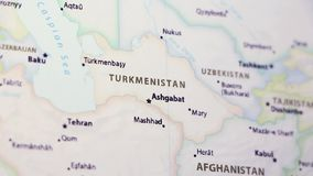 Turkmenistan on a Map. Turkmenistan on a political map of the world. Video defocuses showing and hiding the map stock video