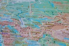Turkmenistan, Uzbekistan, Kyrgyzstan in close up on the map. Focus on the name of country. Vignetting effect royalty free stock photography