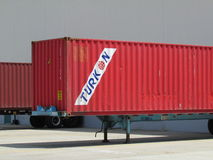 Turkon container at warehouse doors in NJ, USA. Г. Container of Turkon shipping companies being loaded or unloaded NJ, USA Royalty Free Stock Photo