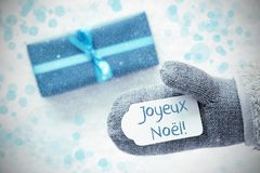 Turkooise Gift, Handschoen, Joyeux Noel Means Merry Christmas, Sneeuwvlokken stock foto