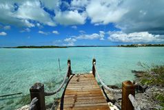Turks and Caicos - Chalk Sound Pier. In the Caribbean, the country of Turks and Caicos, the island of Providenciales, a pier leading out to the turquoise waters Royalty Free Stock Photography