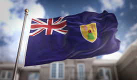 Turks and Caicos Islands Flag 3D Rendering on Blue Sky Building Stock Photo