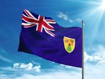 Turks and Caicos Islands flag waving in the blue sky. Turks and Caicos Islander flag waving in the blue sky Stock Photos
