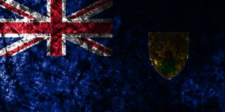 Turks and Caicos Islands grunge flag on old dirty wall, British Overseas Territories, Britain dependent territory flag. Turks and Caicos Islands smoke flag royalty free illustration