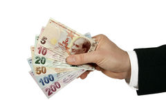 Turkse Lire in de hand van de zakenman stock foto