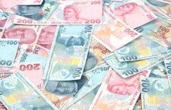 Turkse Lirebankbiljetten (POGING of TL) 100 TL en 200 TL Stock Foto